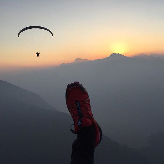 A picture from kathrin's point of view while paragliding